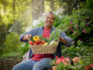 Happy man amidst vegetable shortage