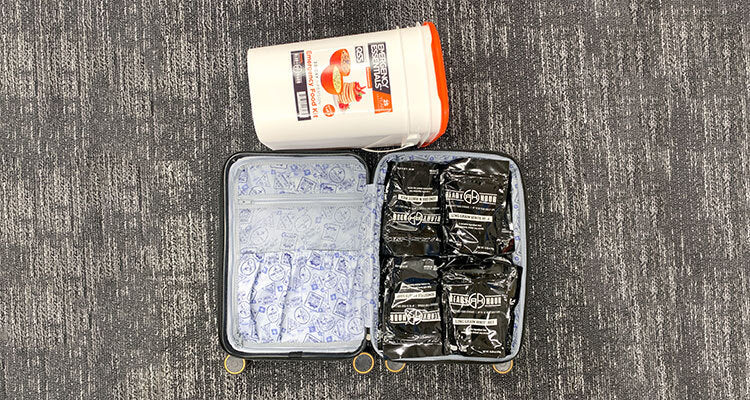 Suitcase full of emergency food pouches