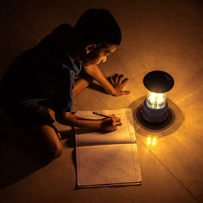 Reading a Book by Lantern Light
