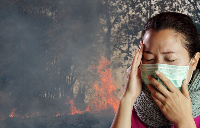 woman in mask and wildfire smoke