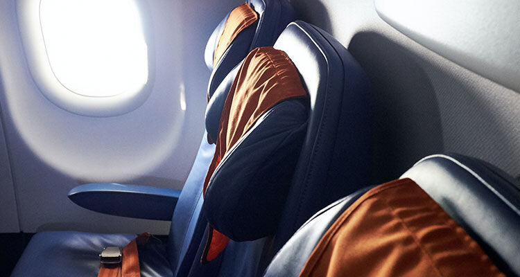 Empty airline seats with blankets draped over them