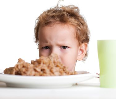 child frustrated with meal