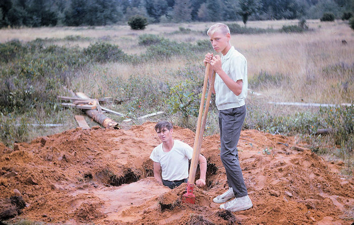two men digging a well