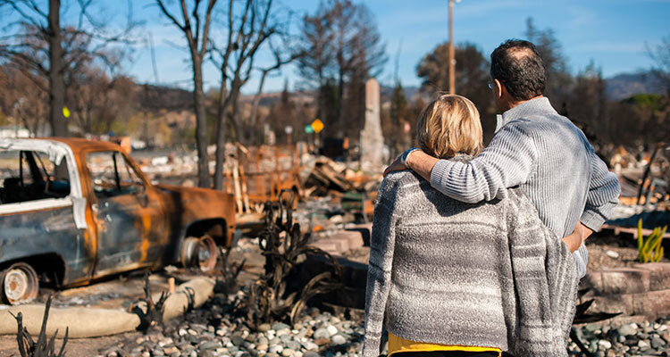 couple watching house torn down