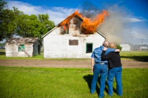 couple and burning house