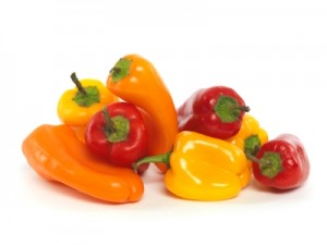 Small colorful sweet peppers isolated on white background
