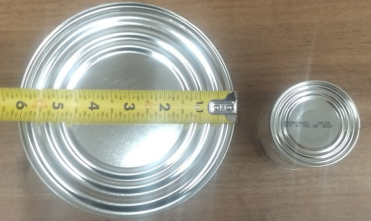 Two cans of different sizes being measured