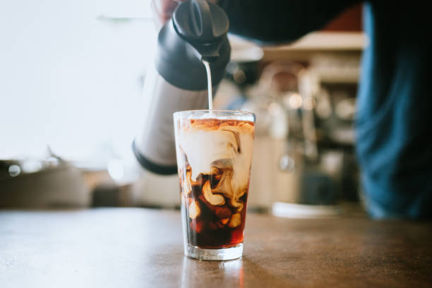 large cup of cold brew coffee with added cream