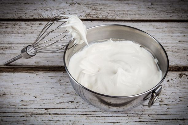 a bowl of runny whipped cream
