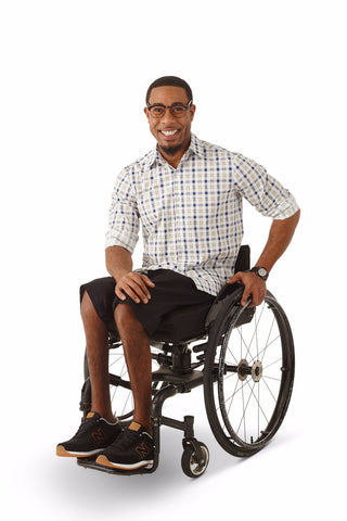 wheelchair model wearing adaptive chino shorts for wheelchair users