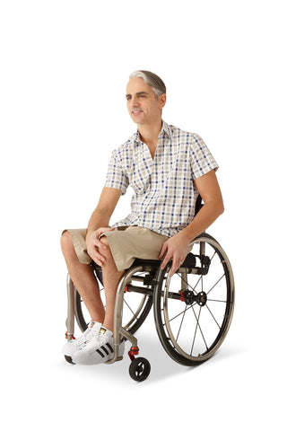 wheelchair model wearing men's adaptive chino shorts