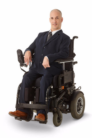 model wears navy dress pants with elastic waist for wheelchair users