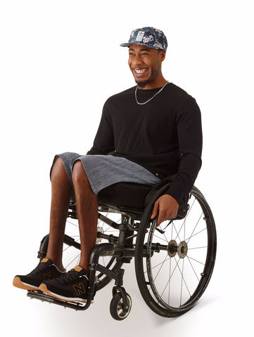 wheelchair model wearing light blue denim shorts