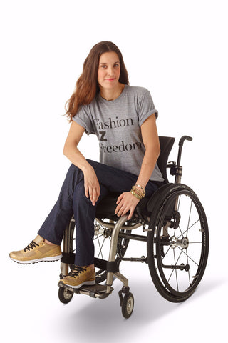 model wears slim leg jeans with IZ panel for wheelchair users
