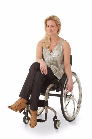 model wears lightweight slim leg jeans with iz panel for wheelchair users