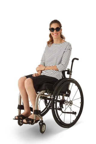 wheelchair model wearing black chino shorts with elastic waistband for women