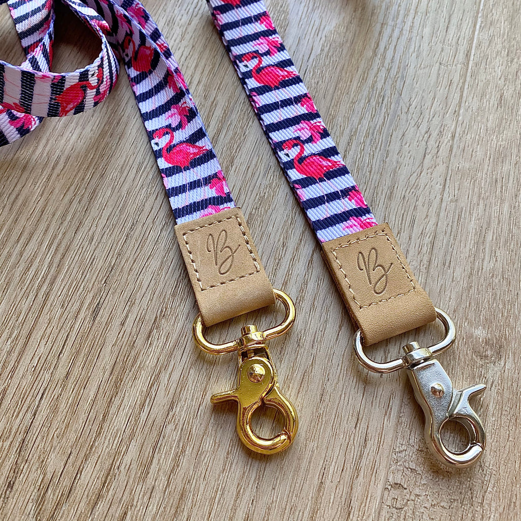 navy blue and white stripes with pink flowers and flamingos on a fabric teacher lanyard