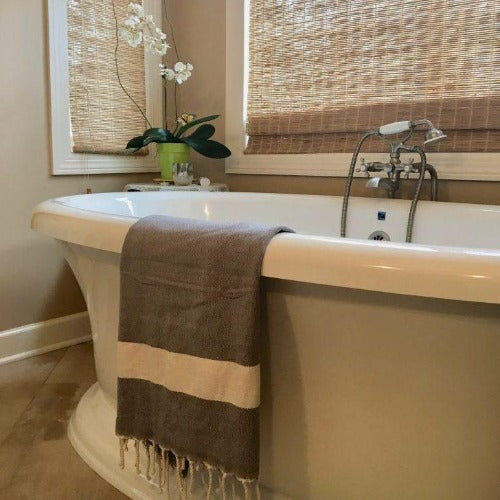 Diamond fouta towel draped over a bathtub