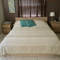 Extra large cotton fouta on a queen bed