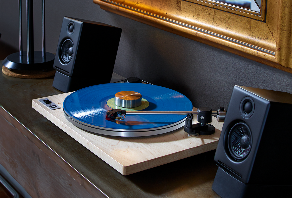 Turntable with speakers on desk
