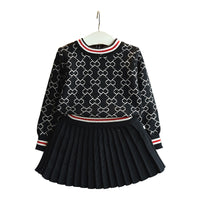 Sweater with pleated skirt