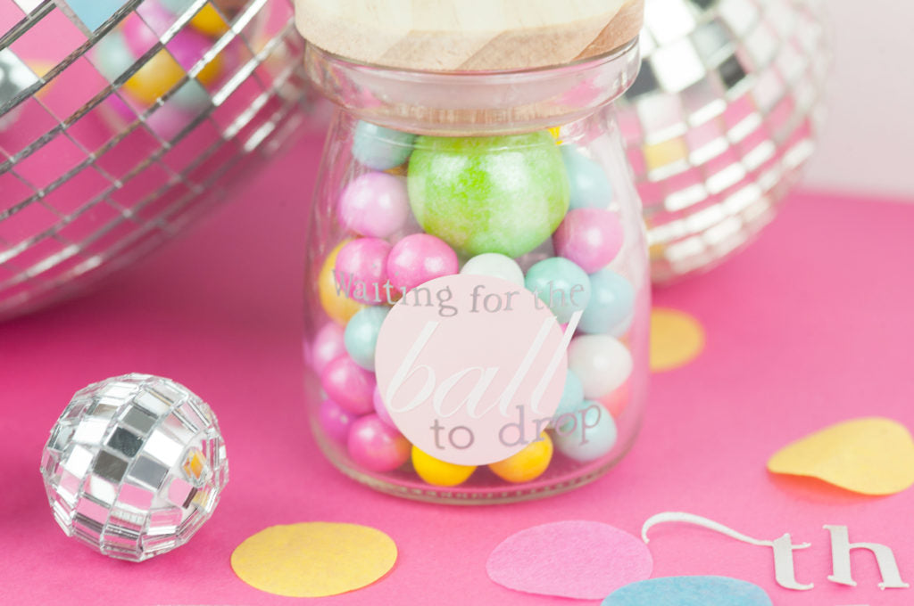 This is a perfect way for the kiddos to enjoy the ball drop. DIY jars filled with gum balls as party favors.