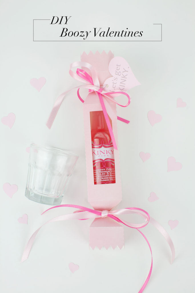 A Boozy new Valentines with mini shot bottles. How fun!