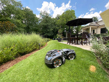 Load image into Gallery viewer, Automower robot lawn mower on a slope