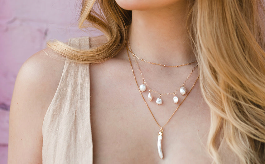 Layered pearl necklaces.