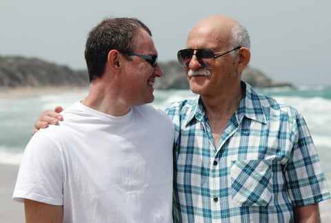 Adult Father With Son on Beach