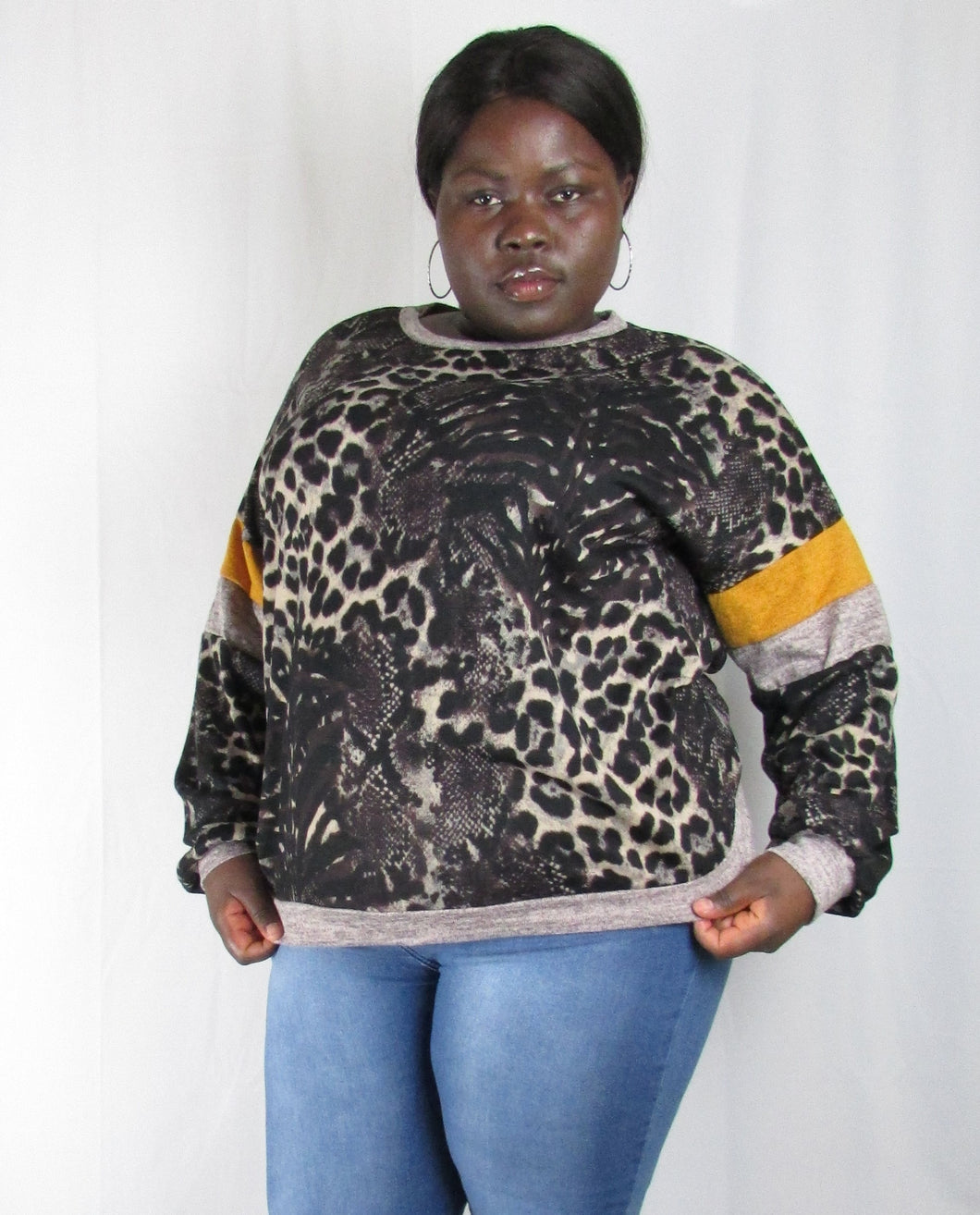 Plus size leopard print sweatshirt with contrast sleeve