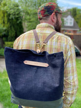Load image into Gallery viewer, Selvedge denim and olive unfolded backpack view