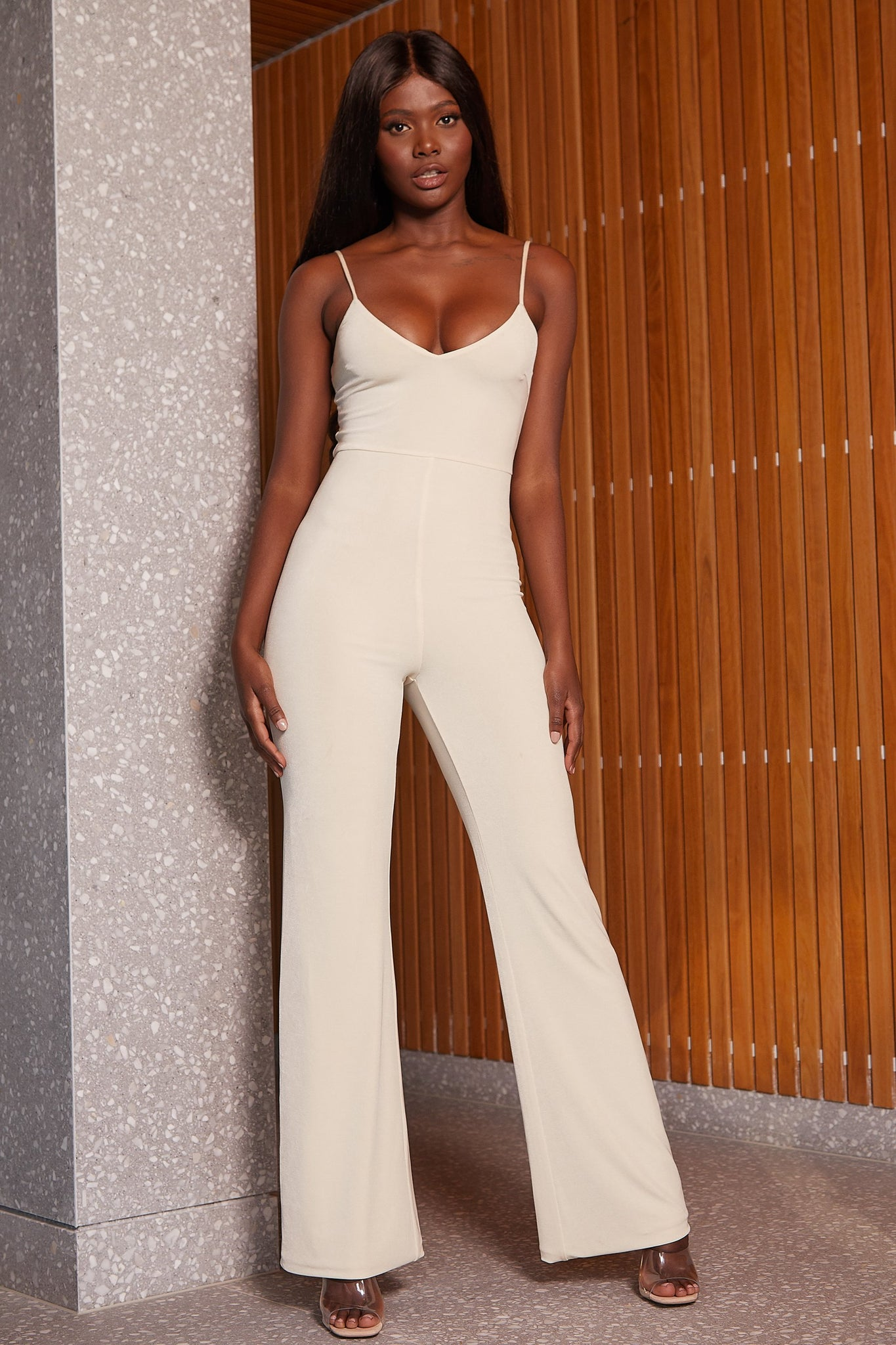 Ellie Luxe Jersey V Neck Flared Leg Jumpsuit - Cream - MESHKI