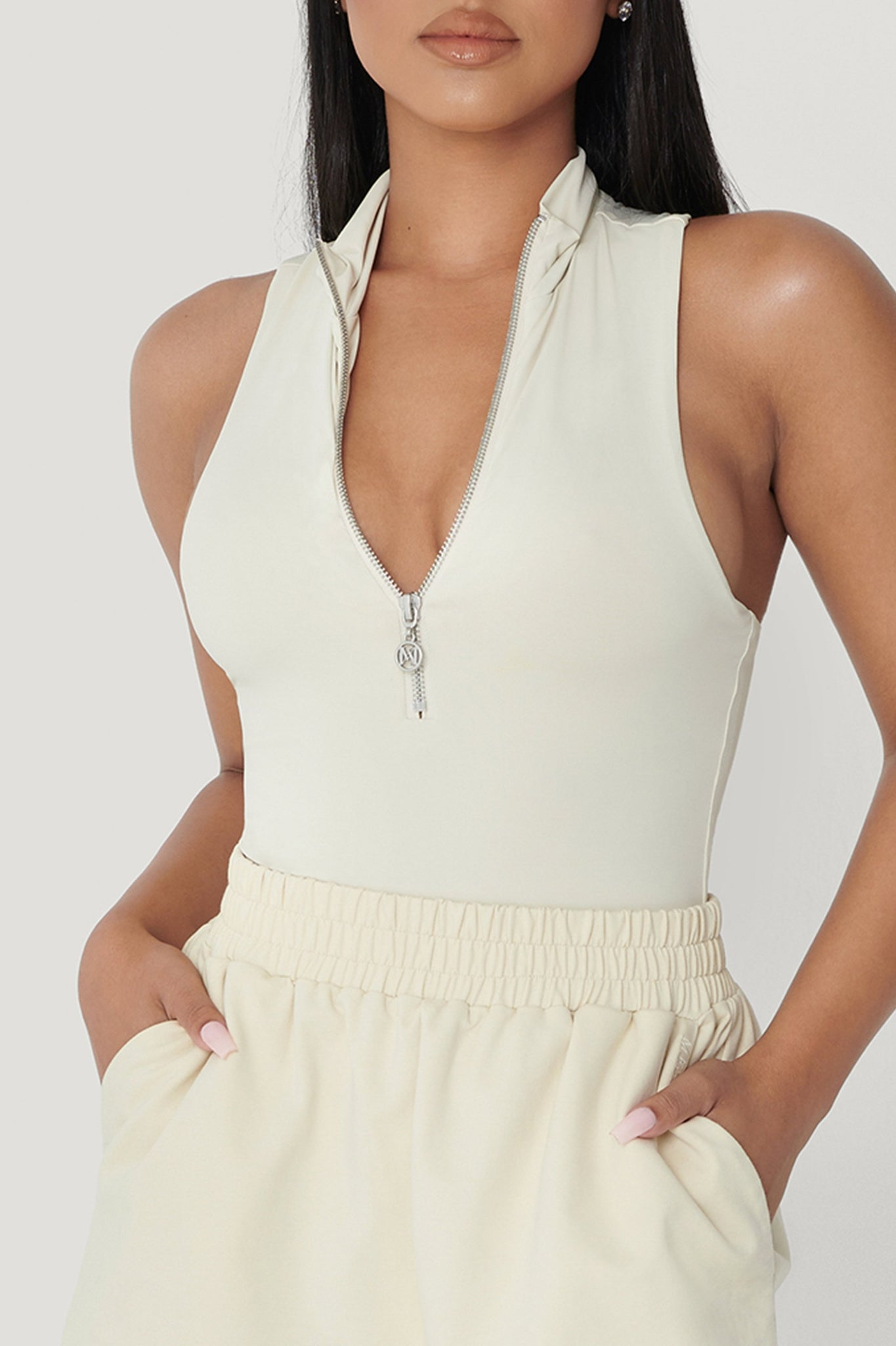 Paulina Sleeveless High Neck Zip Bodysuit - Sand - MESHKI