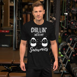 A male model wearing a snowman tee shirts: Christmas graphic tee tops - black heather - side view