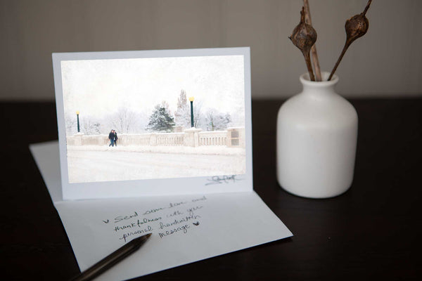 "Hand made Christmas-greeting card featuring ""Going to Grandads'  a photo of two boys walking over Parkhill bridge in Cambridge in a snowy wintery scene Photo by Cambridge Ontario Photographer Laura Cook of Vision Photography"