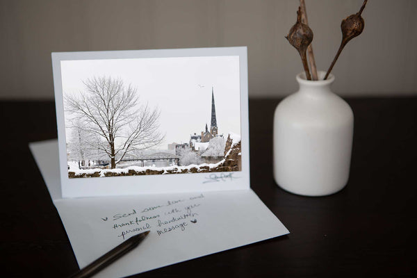 Greeting card featuring photo of millrace park in the winter in the background central presbyterian church. Photo by Cambridge Ontario Photographer Laura Cook of Vision Photography