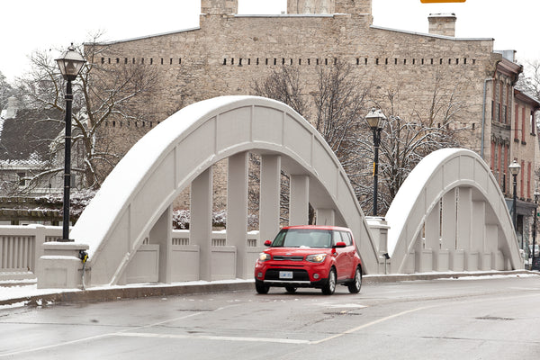 'Cambridge Soul' Photograph of Main Street Bridge in Galt, Cambridge in the winter with a red kia driving over the bridge photograph by Cambridge photographer Laura Cook