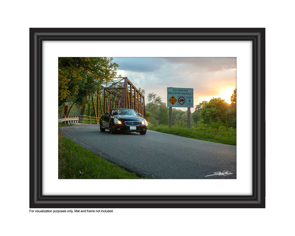 Photo of a Car Driving over Black Bridge in Hespeler at Sunset by Laura COok Vision Photography