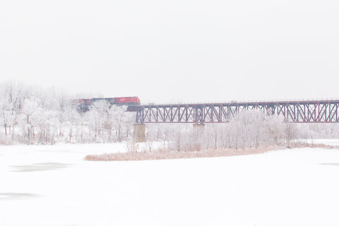 CP Train crossing train Bridge by GCI in Cambridge in the winter Photo by Cambridge Ontario Photographer Laura Cook of Vision Photography