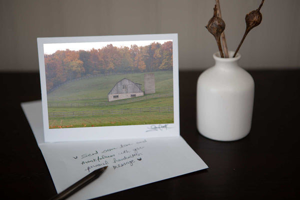 Photo greeting card featuring ' Misty Barn' a fall photograph of a charming barn set in the rolling hills with the autumn colours in the background on a misty day Photo by Cambridge Ontario Photographer Laura Cook of Vision Photography