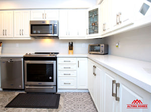 Small All-White Kitchen - Altima Homes Inc.