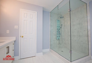 Large Master Bathroom with Vintage Style Tub - Altima Homes Inc.