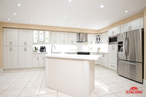 All-White Cabinets, Counter-tops and Floor Tiles Kitchen - Altima Homes Inc.