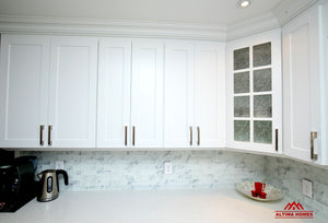 All-White Marble Blacksplash Kitchen - Altima Homes Inc.
