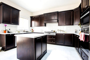 Large Kitchen with Brown Cabinets & White Quartz Counter - Altima Homes Inc.