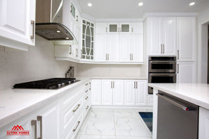 All-White Marble Floor Quartz Countertop Kitchen - Altima Homes Inc.