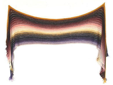 A knitted wrap with short fringe at the ends made from twenty five mini skeins arranged in gradient colour order from purples through greens to creams and pinks through browns to yellows hanging on a white background (Adventuring Wrap by Ambah O'Brien) Edit alt text