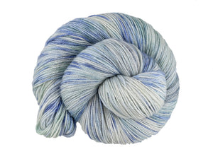 A close up of a variegated white, mauve blue and sea green coloured skein of superwash bluefaced leicester, silk and cashmere 4ply fingering sock yarn presented as a spiral on a white background (Blue Steel on Blue Chip Stocking)