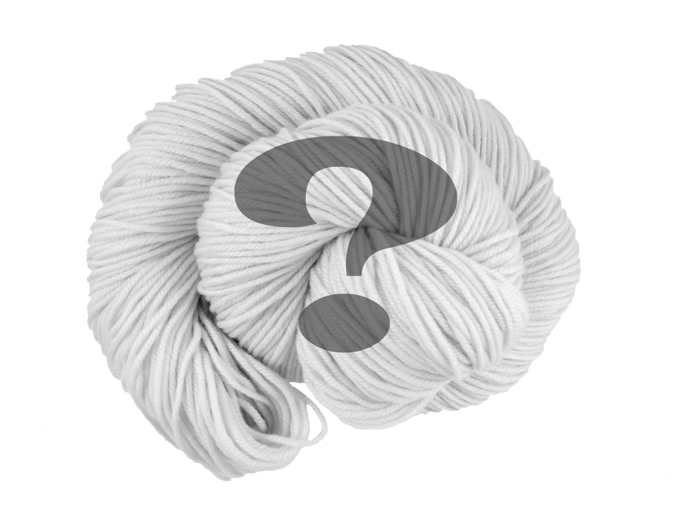 A black and white photo of a spiral of superwash merino, cashmere and nylon 8ply DK weight yarn presented as a spiral on a white background. Superimposed on top is a transparent grey question mark (Undyed on Mother's Love DK)